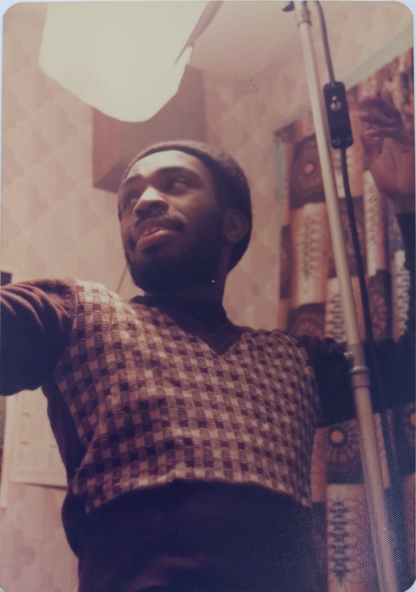 Menelik on set of Step Forward Youth
